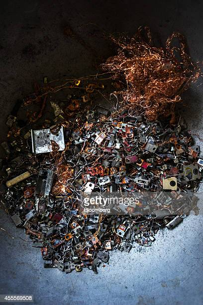 Copper wire and other components recycled from electronic waste sit in a pan at a house in Sangrampur village West Bengal India on Tuesday Sept 9...