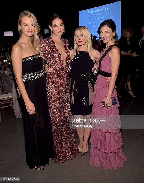 Copresident of Baby2Baby Kelly Sawyer Patricof actress Michelle Monaghan actress Kristen Bell and copresident of Baby2Baby Norah Weinstein attend the...