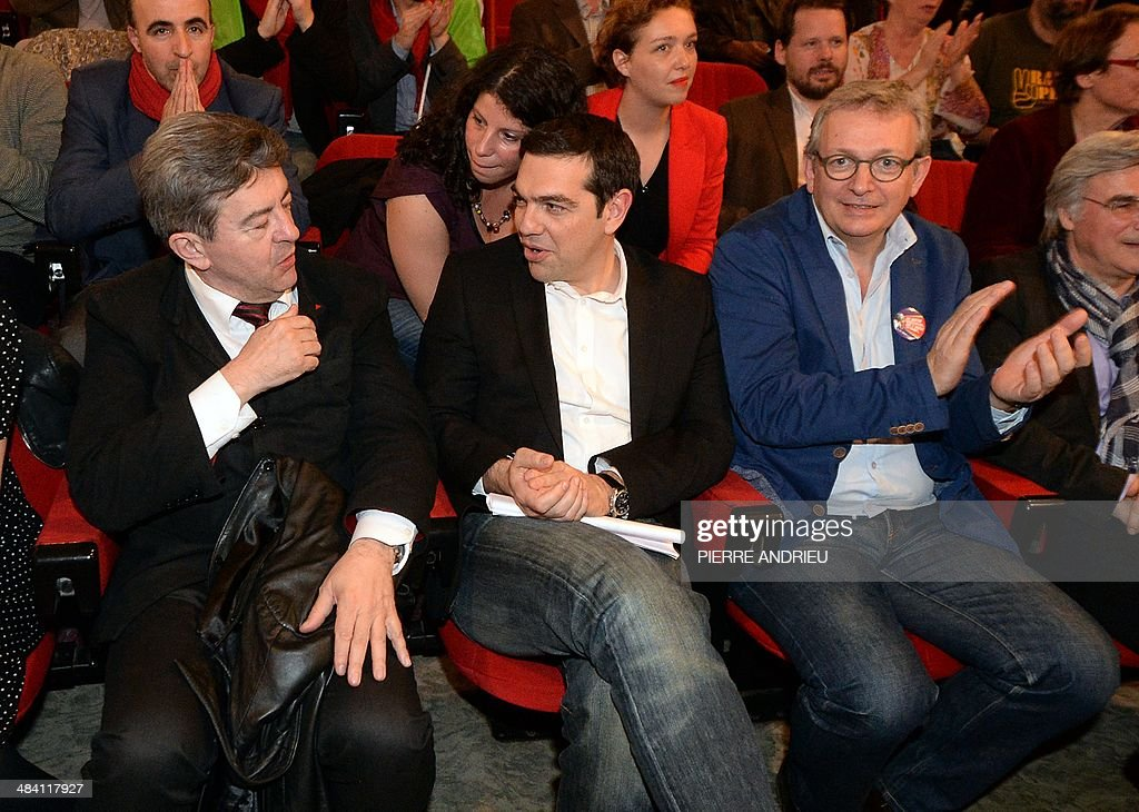 Co-President of the French Left Front party (PG) Jean-Luc Melenchon (L) listens to Greece's Syriza main opposition (radical leftist) party leader Alexis Tsipras (C) as French Communist Party National Secretary Pierre Laurent (R) applauds in Saint-Denis, a Paris suburb, on April 11, 2014, during a campaign meeting of the Front de Gauche (PG and PC, French communist party) six weeks ahead of the European elections. Tsipras is one of the main candidates for the presidency of the European Parliament. AFP PHOTO / PIERRE ANDRIEU