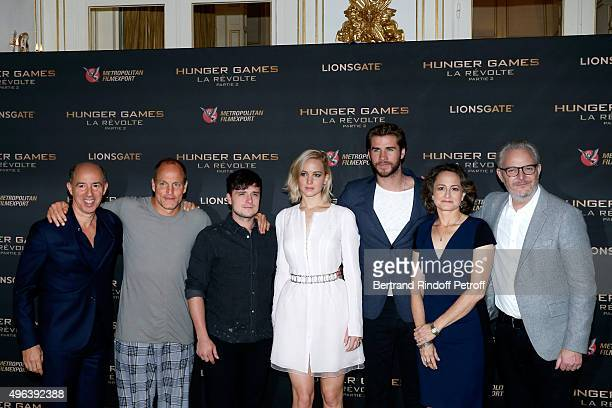 CoProducer Jon Kilik Actors Woody Harrelson Josh Hutcherson Jennifer Lawrence makeup and dressed in Dior Liam Hemsworth CoProducer Nina Jacobson and...