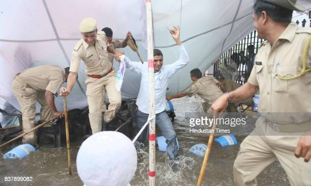Cops posted for duty during nominations for Student Union Polls have a narrow escape as the tent they were sitting under caved in during heavy rains...