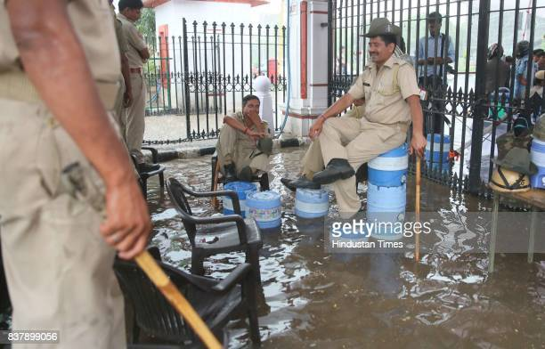 Cops posted for duty during nominations for Student Union Polls perch on water campers to escape waterlogged campus during heavy rains at Rajasthan...