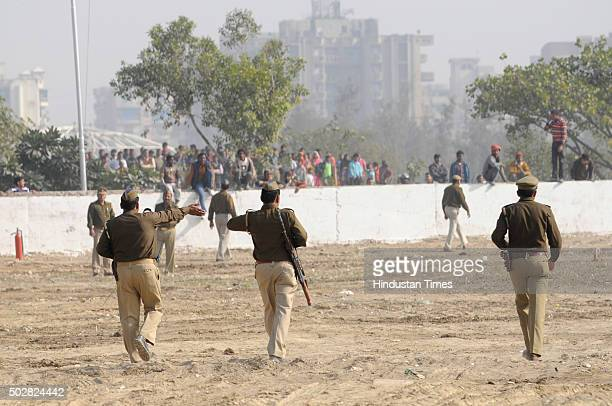 Cops taking stock of the security arrangements at the temporary helipad on December 29 2015 in Noida India A trial landing of a helicopter is being...