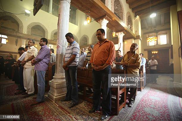 Coptic Christians attend a service in the Church of St Barbera on May 27 2011 in Coptic Cairo Egypt Protests in January and February brought an end...