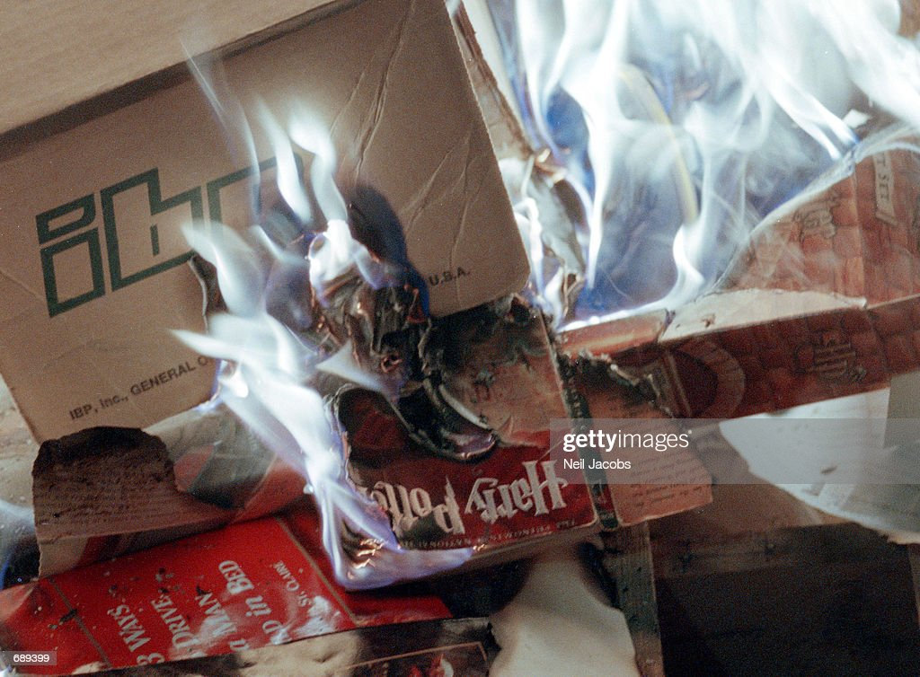 A copy of a Harry Potter book burns in a bonfire during a protest outside the Christ Community Church December 30 2001 in Alamogordo New Mexico The...