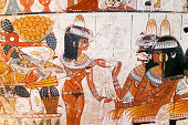 Copy of ancient Egyptian illustration and hieroglyphs engraved and painted on a old stone