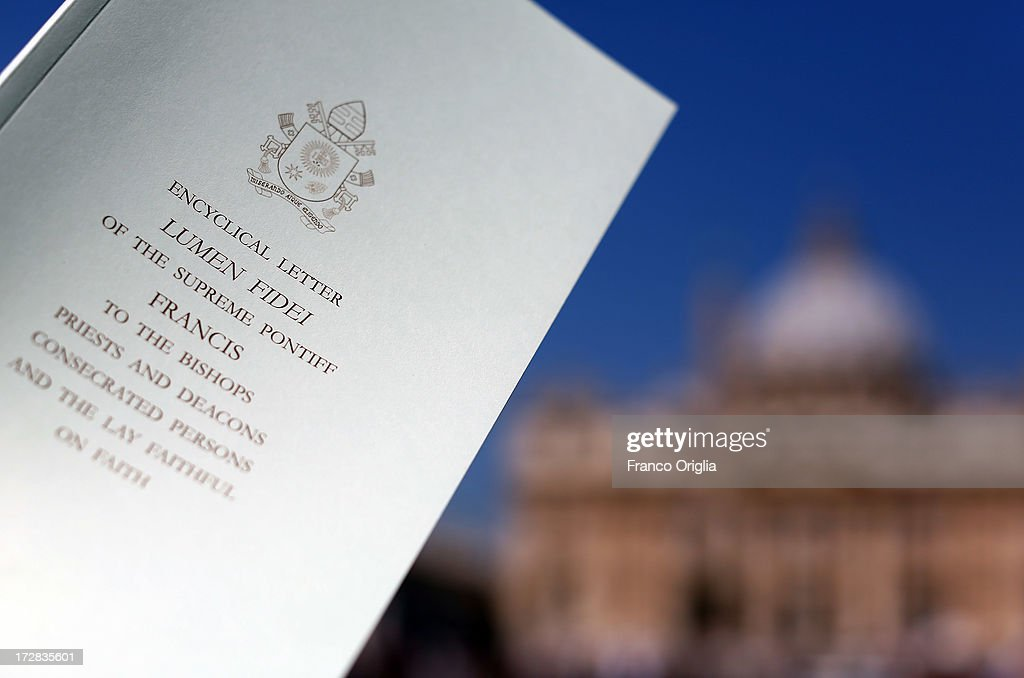 A copy of Pope Francis' first encyclical, entitled 'Lumen Fidei' (The Light of Faith) is shown in St. Peter's Square during a press conference at the Holy See Press Office on July 5, 2013 in Vatican City, Vatican. The document continues many of Benedict's favourite themes, from the complementarity of faith and reason, to the joy of a personal encounter with Christ. Firmly situated in the Year of Faith, it's also set in the context of the 50th anniversary of the Second Vatican Council, which re-established the central role of Faith at the heart of all human relationships.