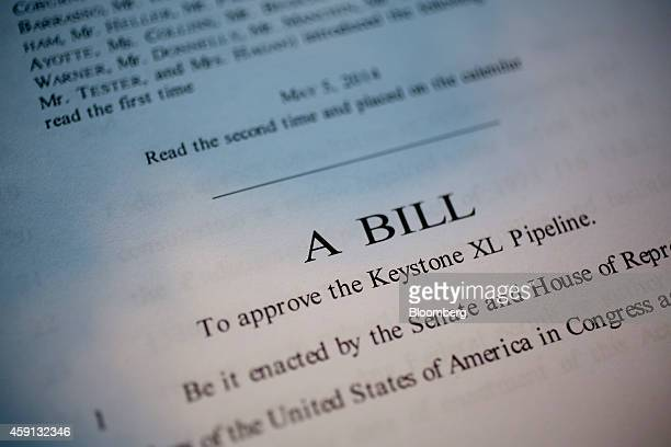 A copy of S 2280 a bill which would approve the Keystone XL Pipeline is arranged for a photograph in Washington DC US on Monday Nov 17 2014 US...