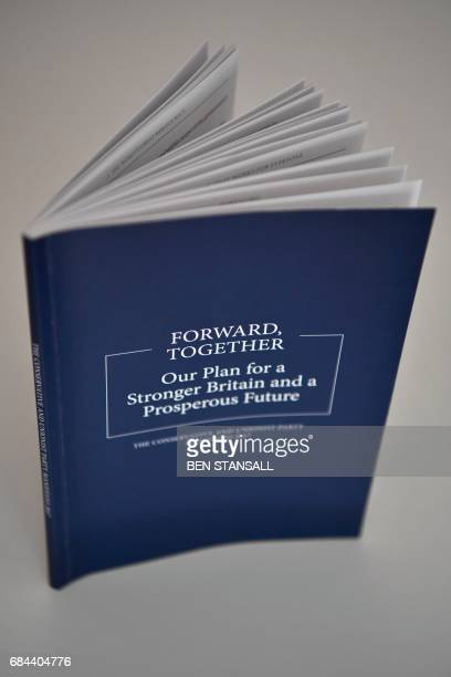 A copy of the Conservative Party general election manifesto is seen at the launch event in Halifax in northern England on May 18 2017 British Prime...
