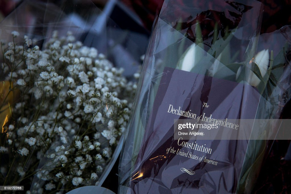 A copy of the Declaration of Independence and Constitution rests with flowers at a makeshift memorial for Supreme Court Justice Antonin Scalia at the U.S. Supreme Court, February 14, 2016 in Washington, DC. Supreme Court Justice Antonin Scalia was at a Texas Ranch Saturday morning when he died at the age of 79.