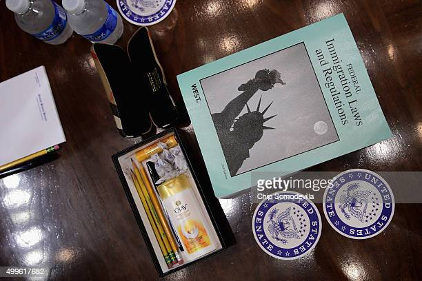 A copy of the Federal Immigration Laws and Regulations and next to a box with throat lozenges hand lotion pencils and lip balm are laid out for US...