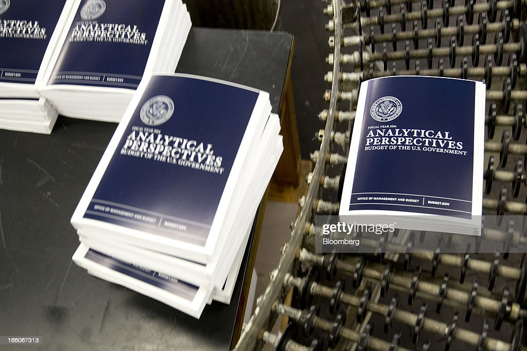 A copy of the Fiscal Year 2014 Budget rolls on a conveyor at the U.S. Government Printing Office in Washington, D.C., U.S., on Monday, April 8, 2013. Less than a week after job-creation figures fell short of expectations and underscored the U.S. economy's fragility, President Barack Obama will send Congress a budget that doesn't include the stimulus his allies say is needed and instead embraces cuts in an appeal to Republicans. Photographer: Andrew Harrer/Bloomberg via Getty Images