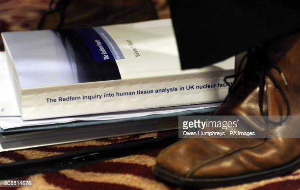 A copy of the inquiry lies on the floor as Michael Redfern QC holds a press conference at the Armathwaite Hall Hotel near Keswick Cumbria after his...
