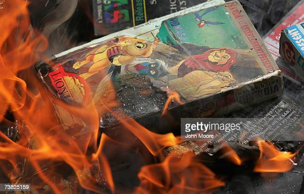 A copy of 'The Lion King' goes up in smoke as students at an Islamic madrassa burn thousands of DVDs videos and music CDs April 6 2007 at the Lal...