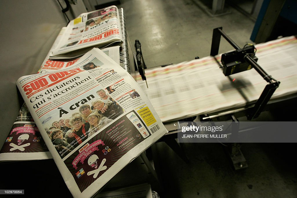 A copy of the Sud-Ouest edition is displayed next conveyor belt of a rotary printing press in the basement of the newspaper on February 19, 2008 in Bordeaux, southern France.
