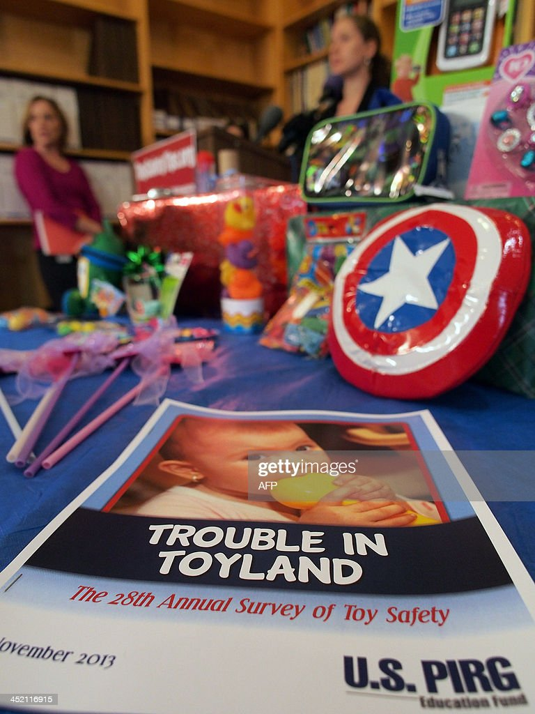 A copy of the US Public Interest Research Group (US PIRG)'s 28th annual 'Trouble in Toyland' survey of toy safety lies on a table of toys of concern at a media event in Washington,DC on November 26,2013 marking its release. Tougher laws have lead to safer toys for US consumers in the run-up to Christmas, but some toys deemed toxic or liable to cause choking still make their way into stores. AFP PHOTO Robert MacPherson
