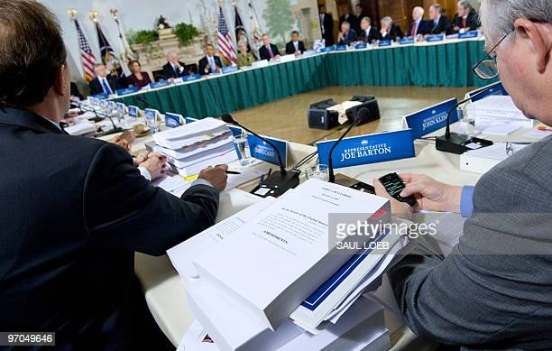 A copy of the US Senate's healthcare reform plan HR 3590 sits between members of Congress as US President Barack Obama speaks while hosting a...