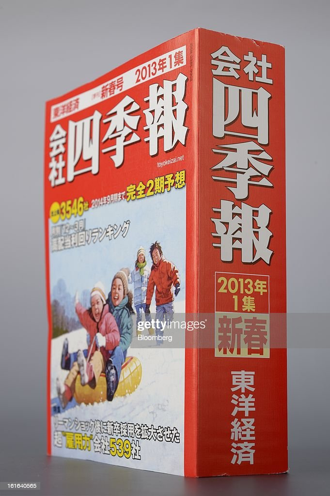 A copy of Toyo Keizai Inc.'s Kaisha Shikiho data book is arranged for a photograph in Kawasaki, Kanagawa Prefecture, Japan, on Wednesday, Feb. 13, 2013. The Kaisha Shikiho, the so-called bible of Japanese equities, has been flying off the shelves since December. Photographer: Akio Kon/Bloomberg via Getty Images
