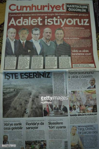 A copy of Turkey's opposition daily newspaper Cumhuriyet is displayed on the screen in Ankara Turkey on September 11 2017 as the daily appears with a...