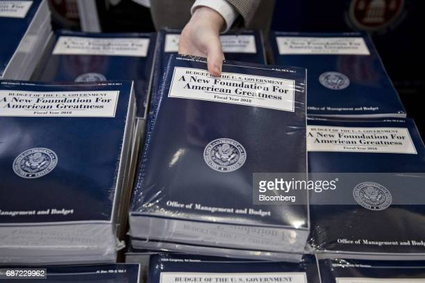 A copy of US President Donald Trump's fiscal 2018 budget proposal is arranged on a table in the Senate Budget Committee hearing room on Capitol Hill...