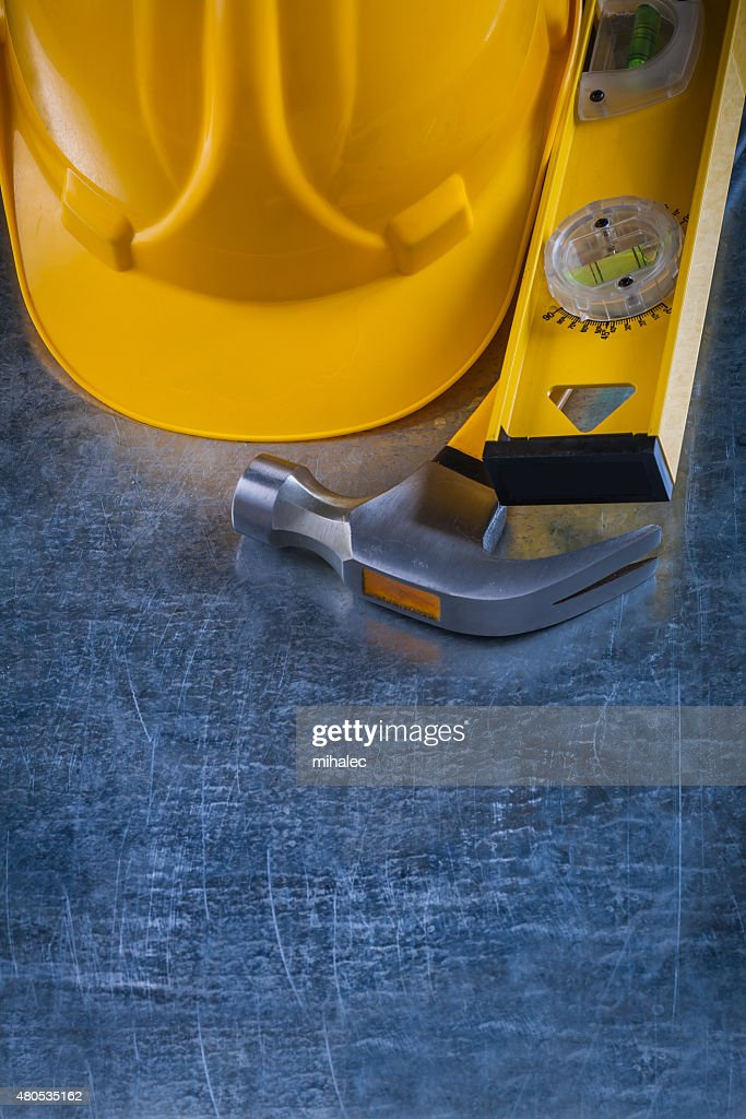 Copy space image of claw hammer construction level and building : Stock Photo