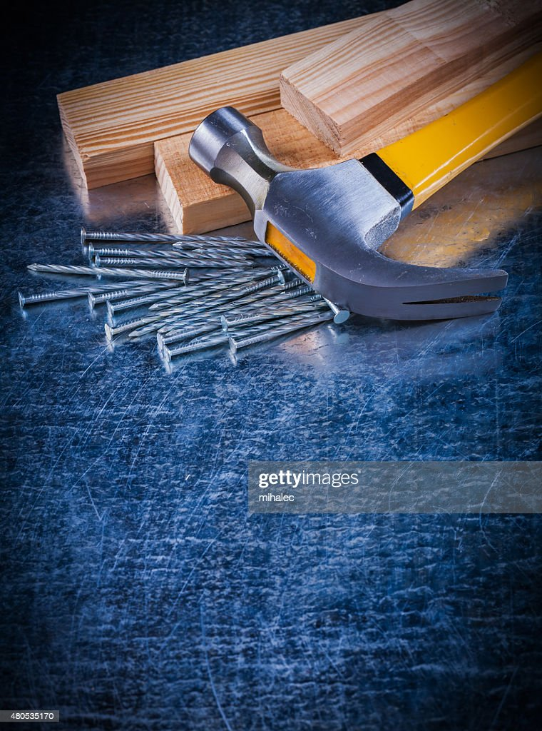 Copy space image of construction nails hammer and wooden bricks : Stock Photo