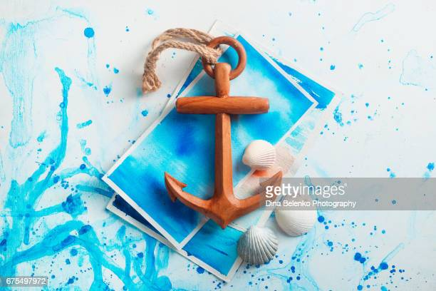 Copy space travel background with wooden anchor