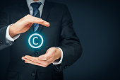 Copyright, patents and intellectual property protection law and rights. Left composition.