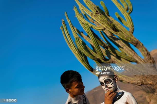Cora Indian boy being painted by his mate prepares himself for the religious ritual ceremony of Semana Santa in Jesús María Nayarit Mexico 21 April...