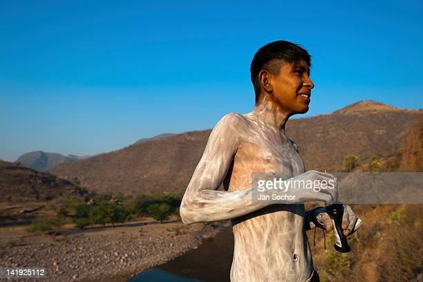 Cora Indian boy painting his body prepares himself for the religious ritual celebration of Semana Santa in Jesús María Nayarit Mexico 21 April 2011...