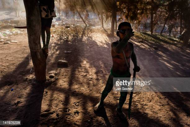 "Cora Indian boy poses for a picture inside ""ramada"" a temporal shack made from branches at the end of the Semana Santa ceremony in Jesús María..."
