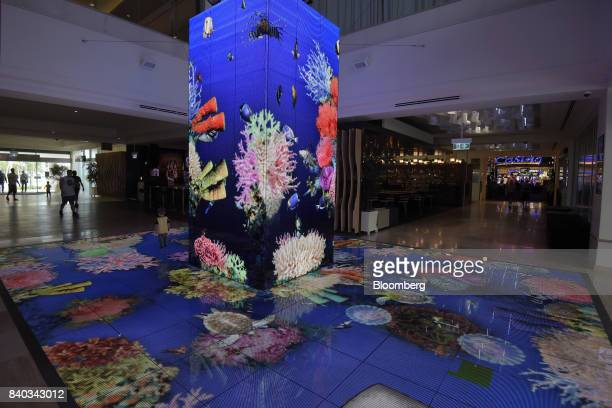 A coral reef LED installation is displayed at the Hotel Pullman Reef Hotel Casino operated by Accor SA in Cairns Australia on Monday July 31 2017...