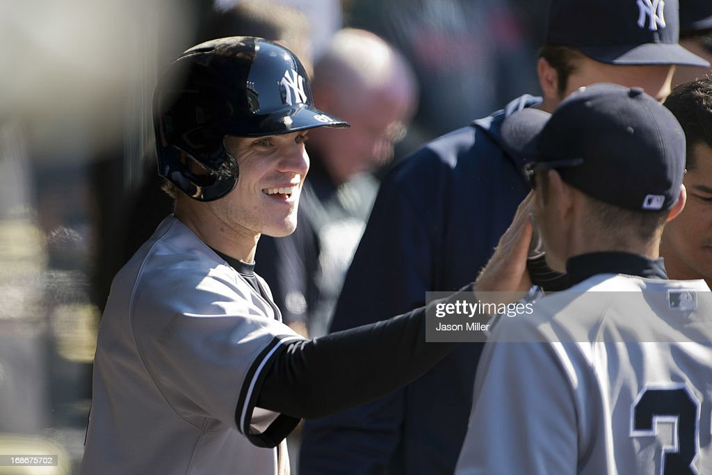 Corban Joseph #61 of the New York Yankees celebrates in the dugout after scoring on a hit by Austin Romine #53 during the sixth inning against the Cleveland Indians during the second game of a doubleheader at Progressive Field on May 13, 2013 in Cleveland, Ohio.
