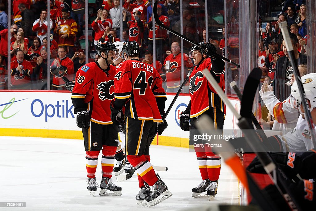 <a gi-track='captionPersonalityLinkClicked' href=/galleries/search?phrase=Corban+Knight&family=editorial&specificpeople=5944763 ng-click='$event.stopPropagation()'>Corban Knight</a> #10 of the Calgary Flames celebrates his first NHL goal with his teammates against the Anaheim Ducks at Scotiabank Saddledome on March 12, 2014 in Calgary, Alberta, Canada.