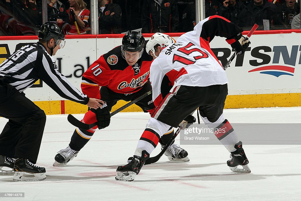 <a gi-track='captionPersonalityLinkClicked' href=/galleries/search?phrase=Corban+Knight&family=editorial&specificpeople=5944763 ng-click='$event.stopPropagation()'>Corban Knight</a> #10 of the Calgary Flames faces off against Zack Smith #15 of the Ottawa Senators at Scotiabank Saddledome on March 5, 2014 in Calgary, Alberta, Canada.