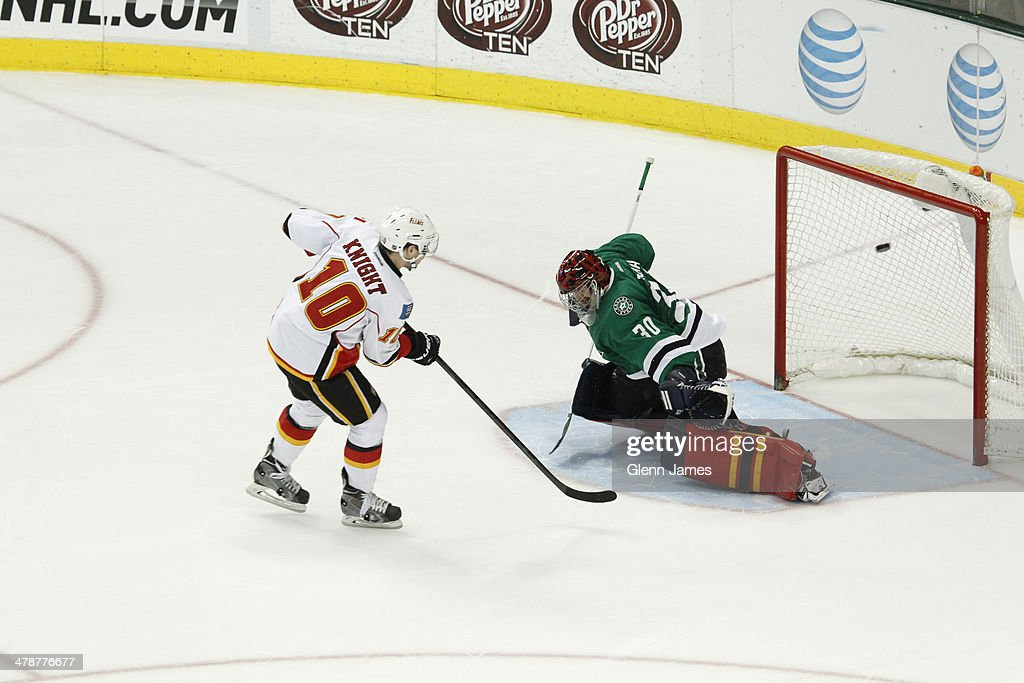 <a gi-track='captionPersonalityLinkClicked' href=/galleries/search?phrase=Corban+Knight&family=editorial&specificpeople=5944763 ng-click='$event.stopPropagation()'>Corban Knight</a> #10 of the Calgary Flames roofs a game winning shootout goal against Tim Thomas #30 of the Dallas Stars at the American Airlines Center on March 14, 2014 in Dallas, Texas.