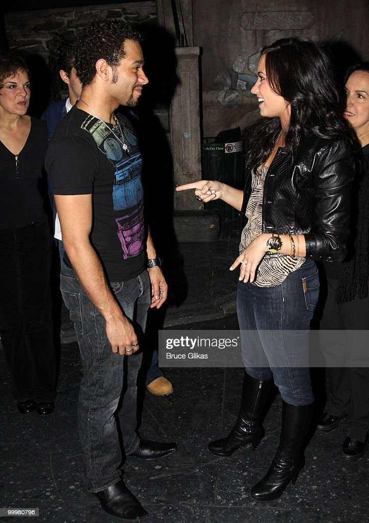 Corbin Bleu and Demi Lovato chat backstage after a performance of 'In The Heights' on Broadway at Richard Rodgers Theatre on May 18 2010 in New York...