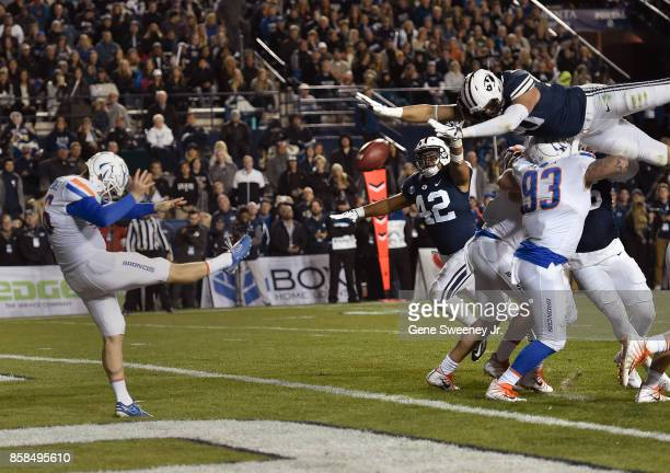 Corbin Kaufusi of the Brigham Young Cougars tries to block the punt of Joel Velazquez of the Boise State Broncos in the first half at LaVell Edwards...