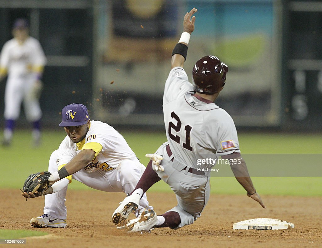 Corbin Smith #21 of TSU slides into second base ahead of the tag by shortstop Walter Wells #2 of Prairie View A&M during the 2013 Urban Invitational, February 23, 2013 in Houston, Texas.