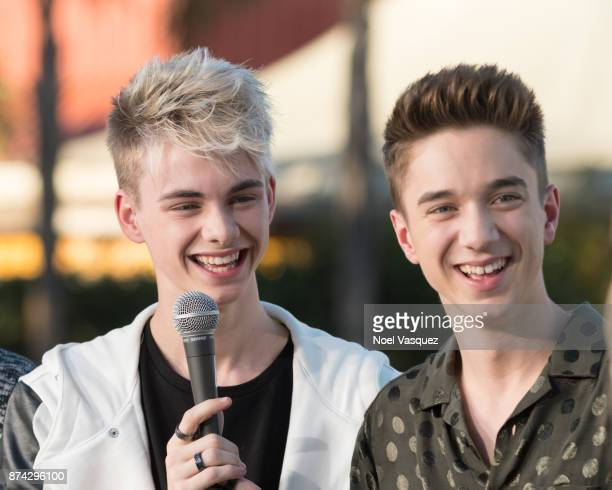 Corbyn Besson and Daniel Seavey of Why Don't We visit 'Extra' at Universal Studios Hollywood on November 14 2017 in Universal City California