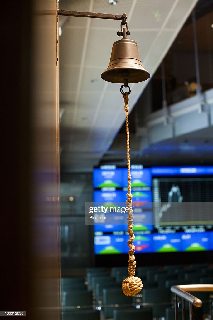 A cord hangs from the opening bell at the Warsaw Stock Exchange in Warsaw, Poland, on Thursday, April 11, 2013. Poland's central bank kept interest rates unchanged at a record-low 3.25 percent yesterday. Photographer: Bartek Sadowski/Bloomerg