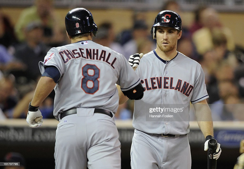Cord Phelps of the Cleveland Indians congratulates Lonnie Chisenhall on a solo home run against the Minnesota Twins during the seventh inning on...