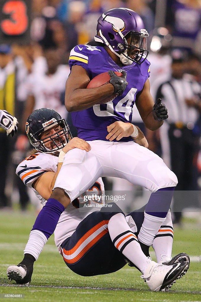 <a gi-track='captionPersonalityLinkClicked' href=/galleries/search?phrase=Cordarrelle+Patterson&family=editorial&specificpeople=9687572 ng-click='$event.stopPropagation()'>Cordarrelle Patterson</a> #84 of the Minnesota Vikings advances the ball while <a gi-track='captionPersonalityLinkClicked' href=/galleries/search?phrase=Patrick+Mannelly&family=editorial&specificpeople=2223034 ng-click='$event.stopPropagation()'>Patrick Mannelly</a> #65 of the Chicago Bears makes the tackle on December 1, 2013 at Mall of America Field at the Hubert Humphrey Metrodome in Minneapolis, Minnesota.