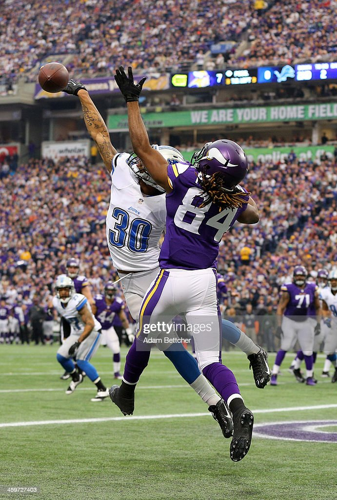 <a gi-track='captionPersonalityLinkClicked' href=/galleries/search?phrase=Cordarrelle+Patterson&family=editorial&specificpeople=9687572 ng-click='$event.stopPropagation()'>Cordarrelle Patterson</a> #84 of the Minnesota Vikings attempts to pull in a pass while <a gi-track='captionPersonalityLinkClicked' href=/galleries/search?phrase=Darius+Slay&family=editorial&specificpeople=8346374 ng-click='$event.stopPropagation()'>Darius Slay</a> #30 of the Detroit Lions blocks it on December 29, 2013 at Mall of America Field at the Hubert H. Humphrey Metrodome in Minneapolis, Minnesota.