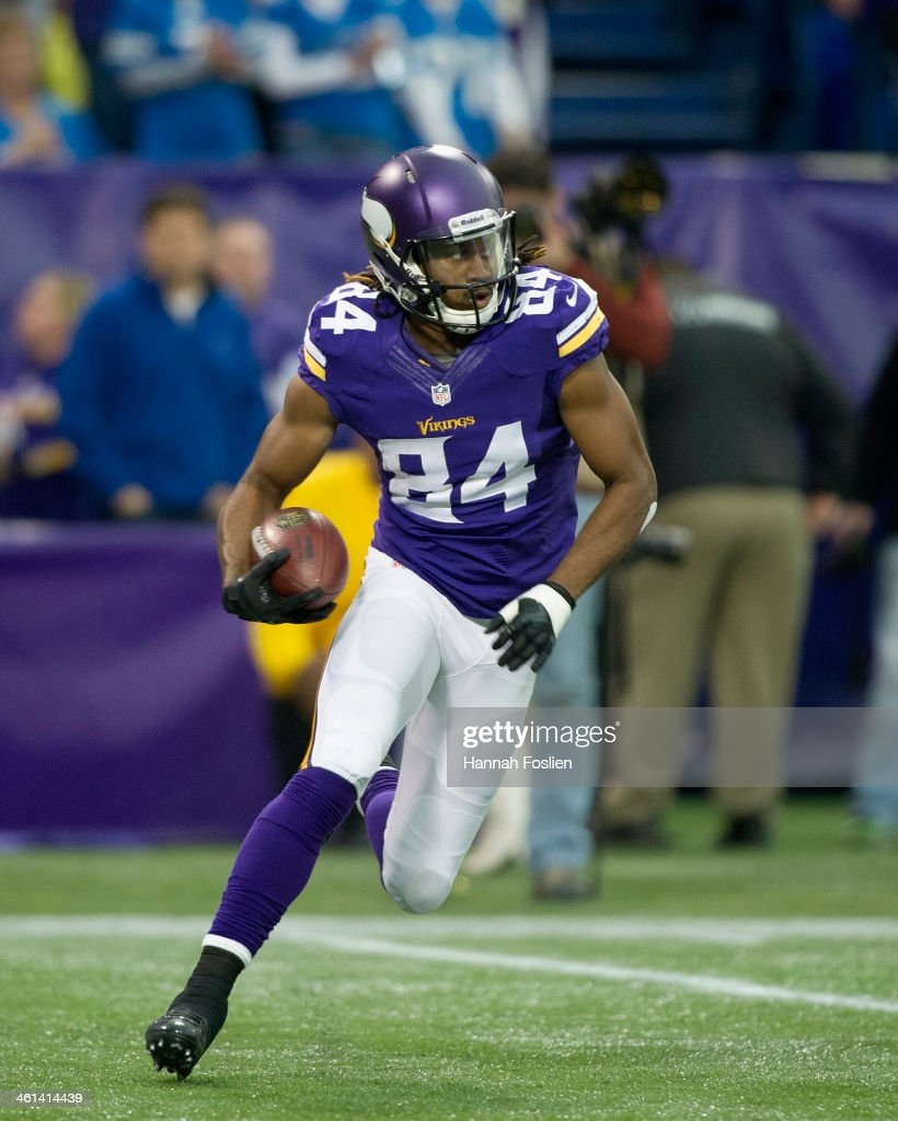 Cordarrelle Patterson #84 of the Minnesota Vikings carries the ball during the game against the Detroit Lions on December 29, 2013 at Mall of America Field at the Hubert H. Humphrey Metrodome in Minneapolis, Minnesota.