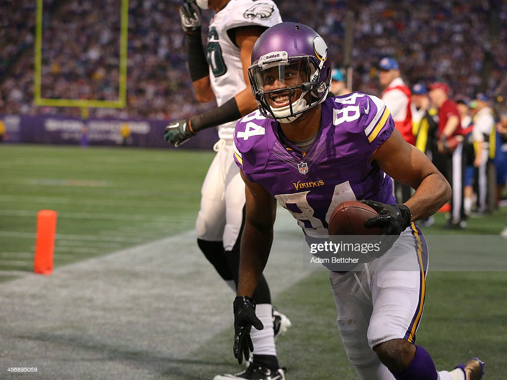 <a gi-track='captionPersonalityLinkClicked' href=/galleries/search?phrase=Cordarrelle+Patterson&family=editorial&specificpeople=9687572 ng-click='$event.stopPropagation()'>Cordarrelle Patterson</a> #84 of the Minnesota Vikings celebrates a touchdown against the Philadelphia Eagles on December 15, 2013 at Mall of America Field at the Hubert H. Humphrey Metrodome in Minneapolis, Minnesota.