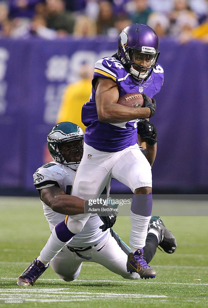<a gi-track='captionPersonalityLinkClicked' href=/galleries/search?phrase=Cordarrelle+Patterson&family=editorial&specificpeople=9687572 ng-click='$event.stopPropagation()'>Cordarrelle Patterson</a> #84 of the Minnesota Vikings feels the pressure from <a gi-track='captionPersonalityLinkClicked' href=/galleries/search?phrase=Trent+Cole&family=editorial&specificpeople=763574 ng-click='$event.stopPropagation()'>Trent Cole</a> #58 of the Philadelphia Eagles on December 15, 2013 at Mall of America Field at the Hubert H. Humphrey Metrodome in Minneapolis, Minnesota.