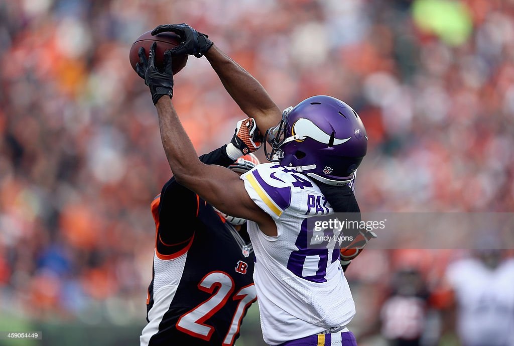 <a gi-track='captionPersonalityLinkClicked' href=/galleries/search?phrase=Cordarrelle+Patterson&family=editorial&specificpeople=9687572 ng-click='$event.stopPropagation()'>Cordarrelle Patterson</a> #84 of the Minnesota Vikings reaches up to catch a pass during the NFL game against the Cincinnati Bengals at Paul Brown Stadium on December 22, 2013 in Cincinnati, Ohio.