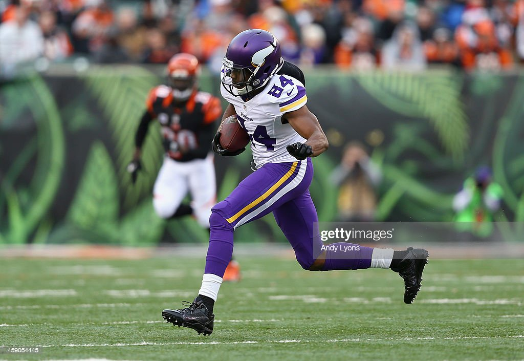 <a gi-track='captionPersonalityLinkClicked' href=/galleries/search?phrase=Cordarrelle+Patterson&family=editorial&specificpeople=9687572 ng-click='$event.stopPropagation()'>Cordarrelle Patterson</a> #84 of the Minnesota Vikings runs with the ball during the NFL game against the Cincinnati Bengals at Paul Brown Stadium on December 22, 2013 in Cincinnati, Ohio.
