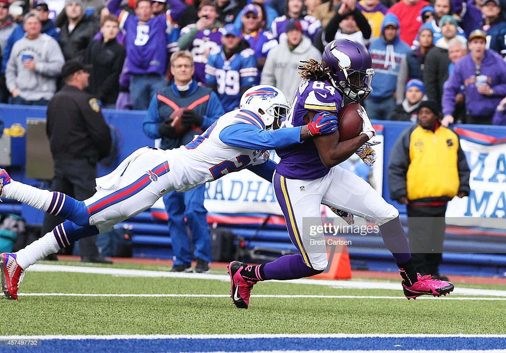 <a gi-track='captionPersonalityLinkClicked' href=/galleries/search?phrase=Cordarrelle+Patterson&family=editorial&specificpeople=9687572 ng-click='$event.stopPropagation()'>Cordarrelle Patterson</a> #84 of the Minnesota Vikings scores a touchdown as <a gi-track='captionPersonalityLinkClicked' href=/galleries/search?phrase=Corey+Graham&family=editorial&specificpeople=4294650 ng-click='$event.stopPropagation()'>Corey Graham</a> #20 of the Buffalo Bills defends during the first half at Ralph Wilson Stadium on October 19, 2014 in Orchard Park, New York.